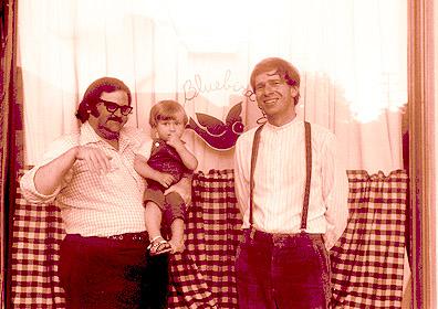 Don Robertson, bartender at the Bluebird Café, along with Misha and Peter Feldmann, 1972