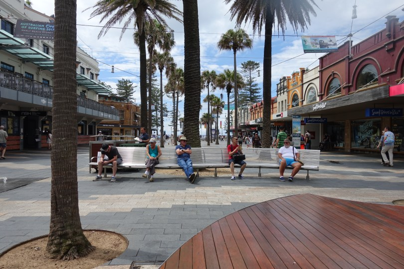 men on bench in Corso Manly Australia