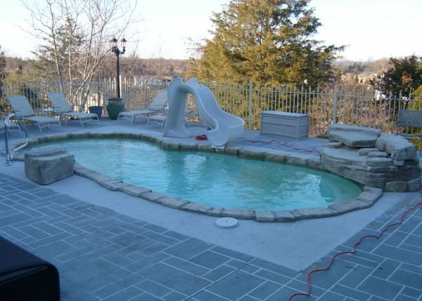 in ground swimming pool builder Michigan Clarston, Milford, Fenton, Oxford, Lansing, Shelby Mi. inground Swimming pool Installation Clarkston Michigan Swimming Pool Sale www.bluehawaiianpoolsofmichigan.com 16 - blue hawaiian pools of michigan sea swirl pool 09e