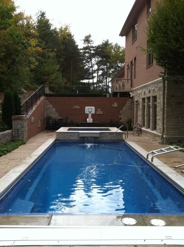 in ground swimming pool builder Michigan Clarston, Milford, Fenton, Oxford, Lansing, Shelby Mi. inground Swimming pool Installation Clarkston Michigan Swimming Pool Sale www.bluehawaiianpoolsofmichigan.com 13 - 1162
