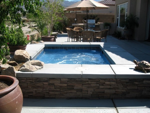 in ground swimming pool builder Michigan Clarston, Milford, Fenton, Oxford, Lansing, Shelby Mi. inground Swimming pool Installation Clarkston Michigan Swimming Pool Sale www.bluehawaiianpoolsofmichigan.com 13 - 1208