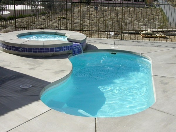 in ground swimming pool builder Michigan Clarston, Milford, Fenton, Oxford, Lansing, Shelby Mi. inground Swimming pool Installation Clarkston Michigan Swimming Pool Sale www.bluehawaiianpoolsofmichigan.com 13 - 1272