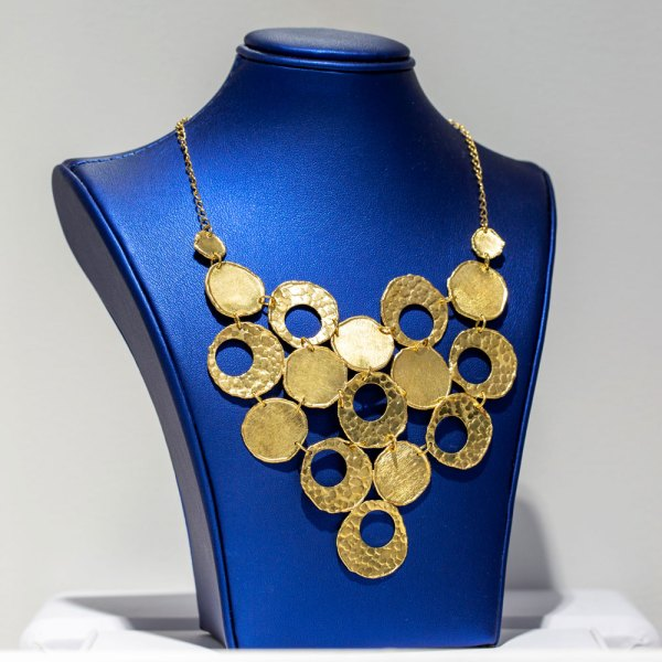 Yellow Gold Circle Bubble Necklace on a blue display element.