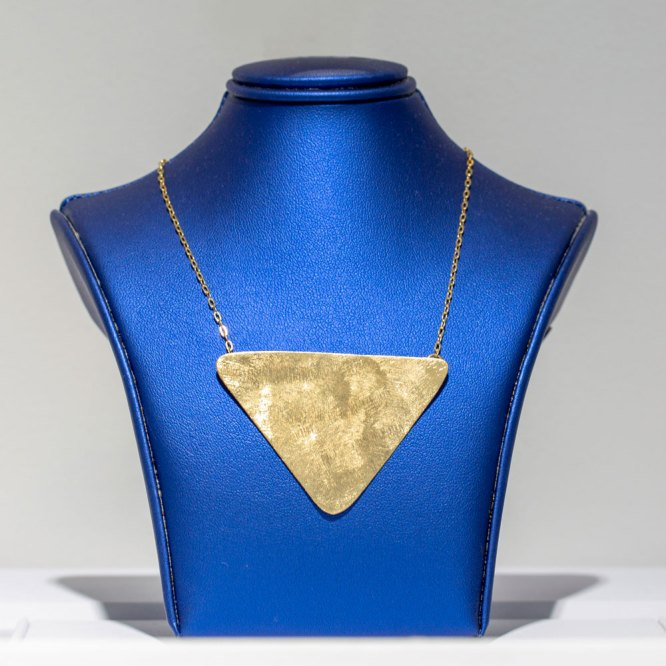 Yellow Gold Triangular Necklace on a blue display element.