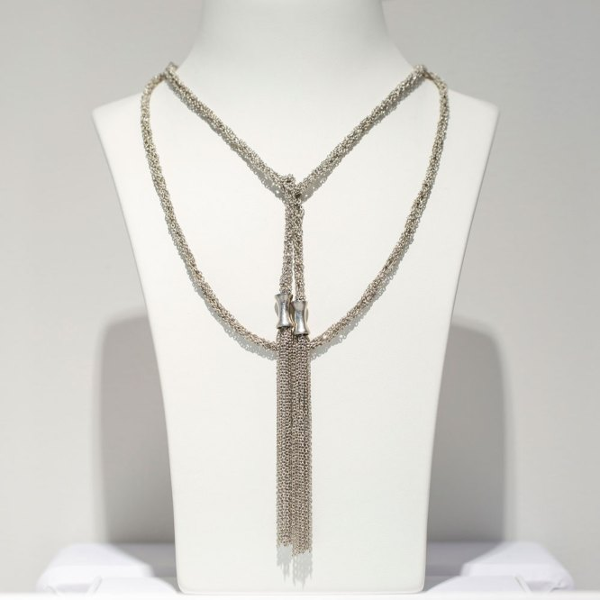 Rhodium Mesh Lariat with Tassels Necklace on a white display element.