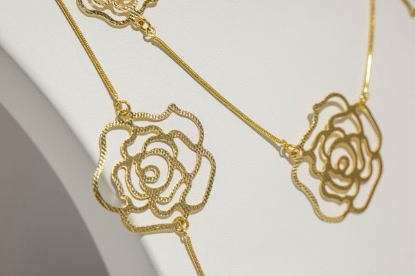 Yellow Gold Small & Large Roses Necklace close up showing rose details.