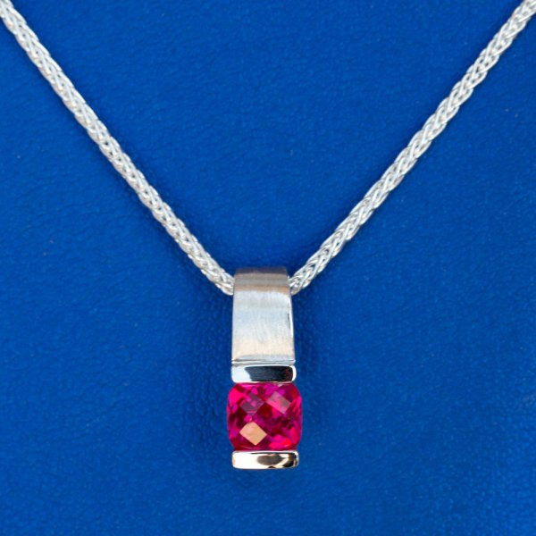 Pink Topaz Pendant front view on a blue background.
