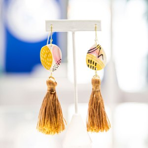 Pink, Gold, Cream Porcelain Earrings with Tassel on a white display element.