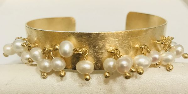 Dangle Pearl Cuff on a white display element.