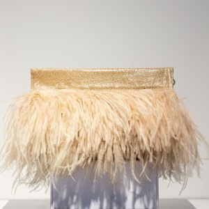 beige ostrich feather clutch front view on a white stand.