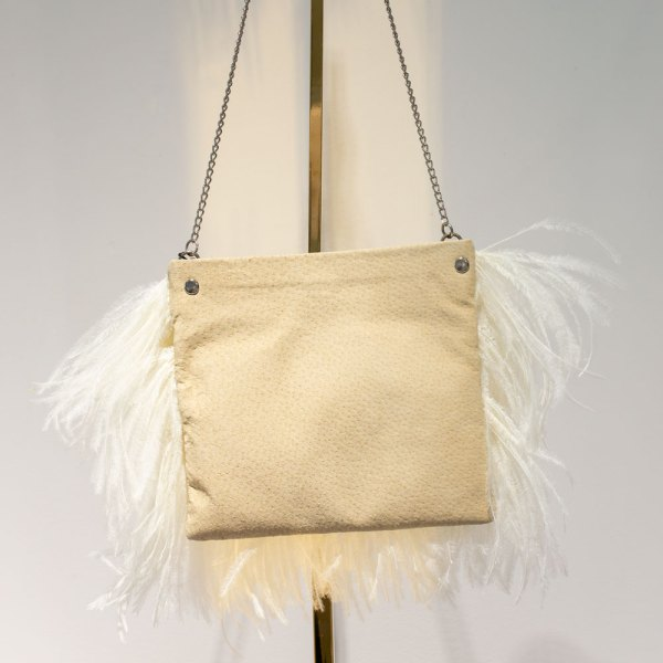 Fancy White Ostrich Feather Handbag back view hanging on a gold stand.