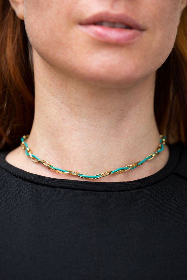Turquoise Leather Yellow Gold Chain Choker on a model.
