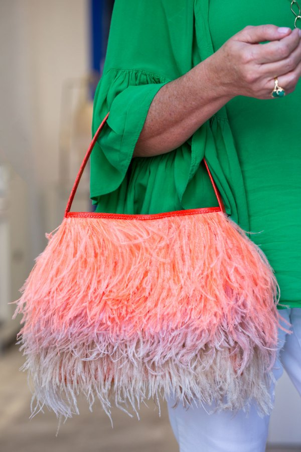 Coral/Blush Shayleen Purse on a models arm.
