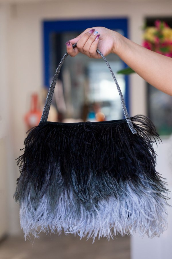 Black/Charcoal Grey Shayleen Purse held in a models hand by the handle.