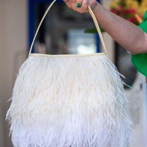 Cream/White Shayleen Purse held in a models hand by the handle.