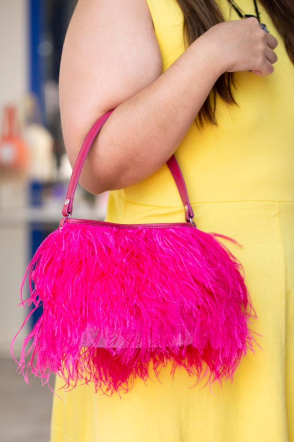 Hot Pink Yumi Bag on a models forearm.