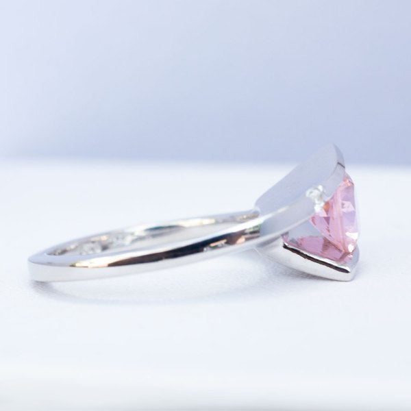 Sunset Quartz & White Sapphire Ring side view laying down.