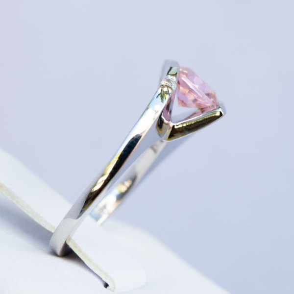 Sunset Quartz & White Sapphire Ring side view standing in a display element.