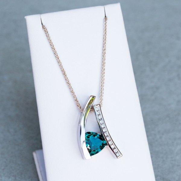 Trillion Cut Caribbean Blue Quartz Pendant with White Sapphires on a white display element.