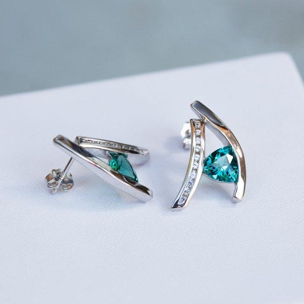 Trillion Cut Caribbean Blue Quartz & White Sapphire Earrings with one turned sideways.