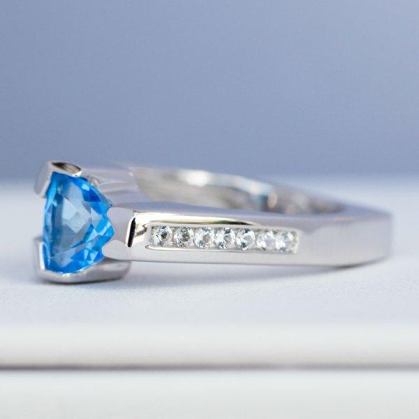 Kashmir Blue Topaz & White Sapphire Ring side view laying down.