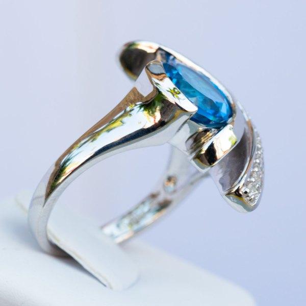 Kashmir Blue Topaz & White Sapphire Wave Ring side view.