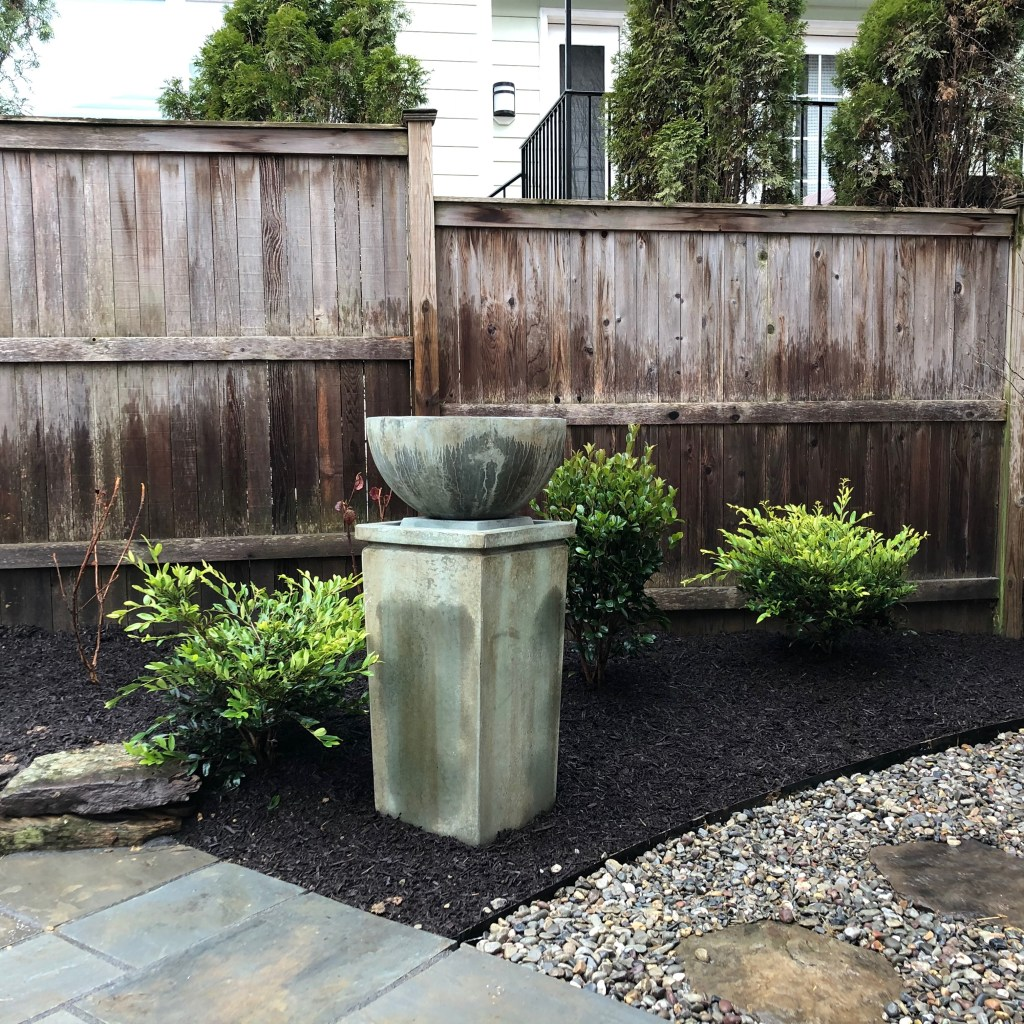 Photo of fountain in planting bed