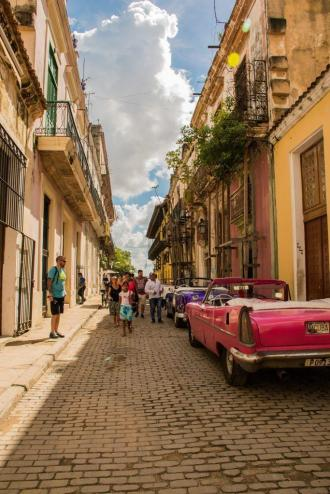 Colourful streets of Havana with shiny convertibles