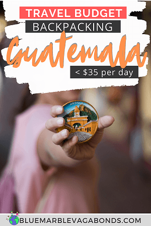 Guatemala travel budget Pin - a hand holding Antigua souvenir magnet