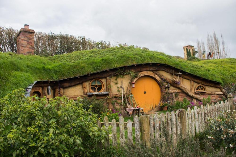 Hobbit hole with yellow round door and all the details.