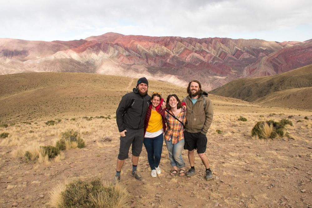 Us and two friends with the Rainbow Mountain, Argentina in the distance