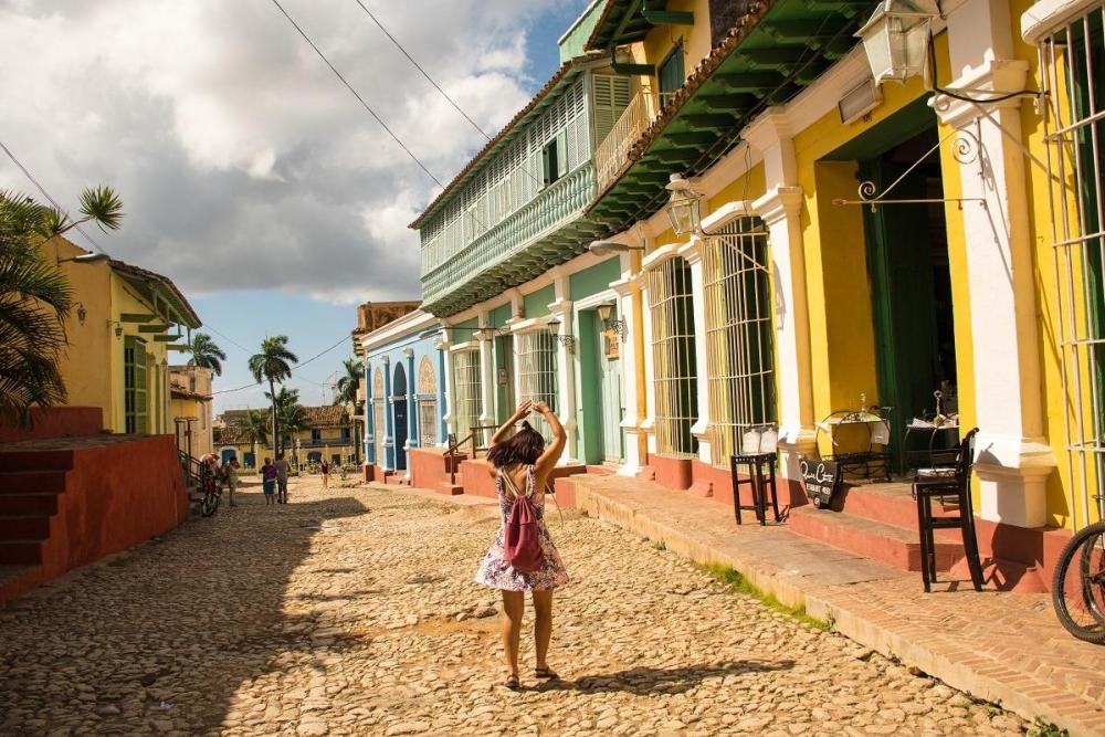 A girl on colorful streets of Trinidad, Cuba