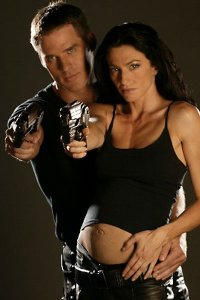 Ben Browder as John Chrichton and Claudia Black as a pregnant Aeryn Sun.