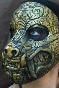A golden wolf mask with delicate swirls.