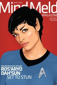 Rosario Dawson as a Vulcan wearing a blue Starfleet uniform.