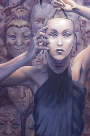 A slender woman hides her face behind a passive mask, with a wall full of other masks behind her.