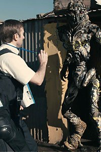 Agent Wikus attempting to evict a nonhuman from District 9.