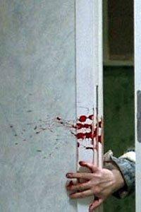 Eli's bloody hand in