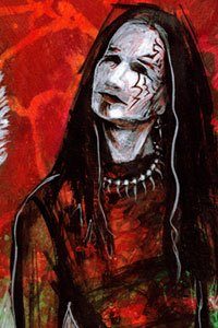 A lanky man with long black hair and white face makeup.