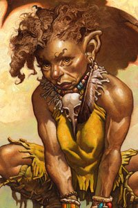 A small woman with wild brown hair and leather skins crouches.