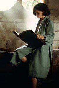 Ofelia (Ivana Baquero) reads the Book of Crossroads.