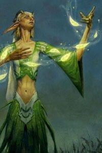 A slender elf in green robes conjures a string of lights.