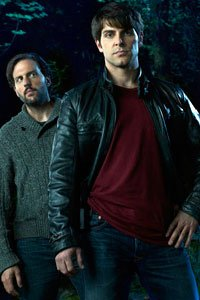 Silas Weir Mitchell as Eddie Monroe and David Giuntoli as Nick Burkhardt.