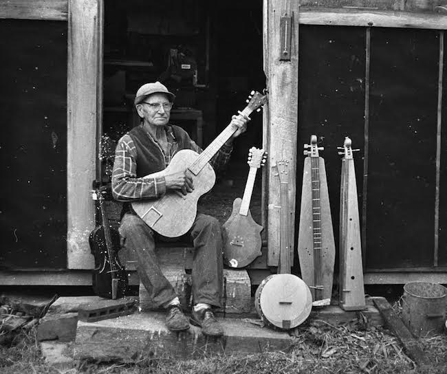Appalachian Musican displaying his instrument collection