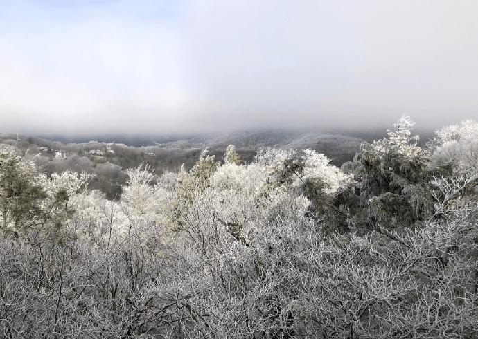 North Carolina Mountains covered with Snow & Fog via canva