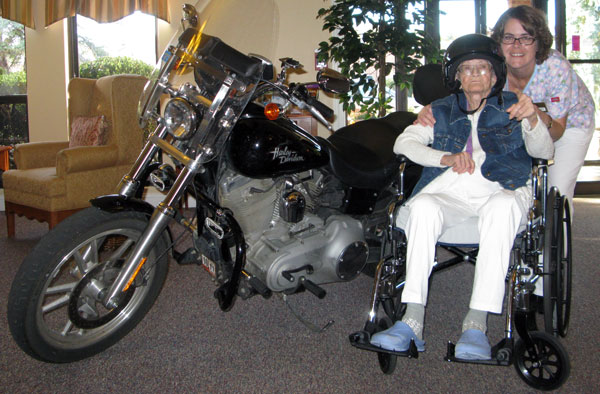 Mom with my bike at her birthday at her assisted living apartment in 2009.