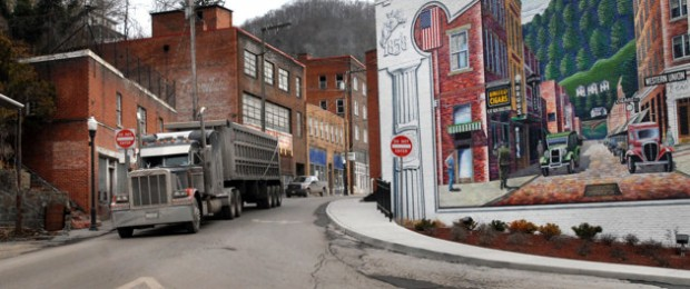 Welch, West Virginia: A coal truck drives out of a town in a county that is considered to be dying. (AP Photo/Jon C. Hancock)