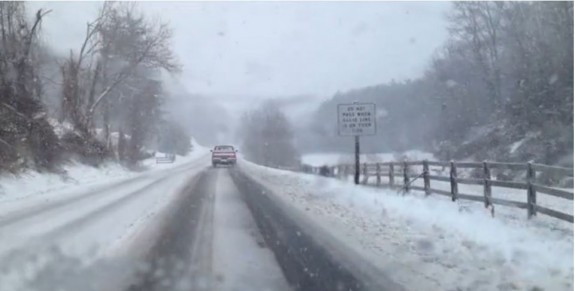 Snow falling along Virginia Route 8 Thursday afternoon.
