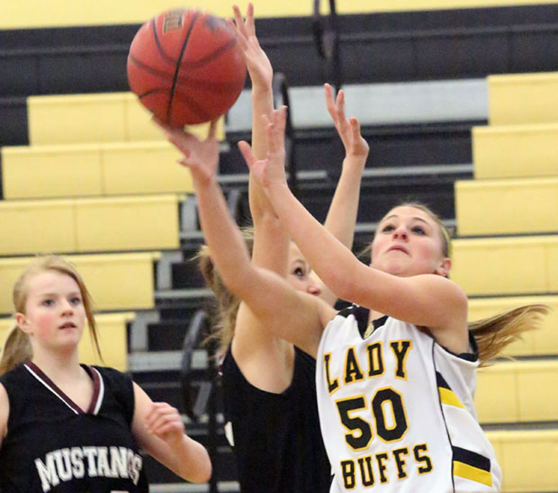 Cassidy Pratt, an 8th grader, goes in for a score for the JV Lady Buffs.