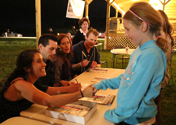 "The cast of ""Geographically Desirable"" signs autographs following the screening at Chantilly Farms Saturday night."